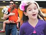 Suri and Tom Cruise FINALLY reunite after more than three months apart as she jets to UK for Thanksgiving