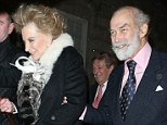 Wind swept: The couple looked happy as they left the exclusive venue despite the inclement conditions
