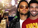 Off the hook: Chris Brown and Drake will not face charges over the nightclub brawl which apparently kicked off over their shared admiration for Rihanna