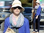 Bargain time! Elizabeth Banks takes baby Felix out for discount goodies on Black Friday