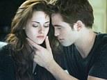 Box office record breaker: Breaking Dawn stars Kristen Stewart, left, and Robert Pattinson have attracted huge audiences