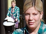 No time for make-up! Mother-of-four Tori Spelling looks exhausted on family day out