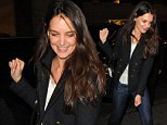 So much to smile about! Katie Holmes flashes a confident grin as she dashes into the theatre ahead of her Broadway show