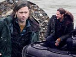 Commander of land and sea: Brad Pitt enjoys a ride on a dingy as he re-shoots scenes for World War Z