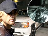 Pictured: Gabriel Aubry leaves jail covered in a blanket as he's ordered to stay 100 yards away from daughter Nahla following brutal Thanksgiving brawl with Martinez
