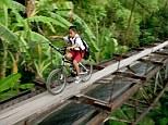 Risky route: A school child crosses the aqueduct that separates Suro Village and Plempungan Village in Java, Indonesia