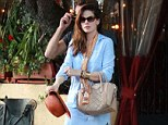 Slim and trim: The actress showed off her svelte figure in the ensemble as she left the restaurant in Los Angeles