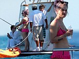 Catch of the day! Kelly Osbourne 'frills' in a hot pink bikini as she goes fishing during vacation with boyfriend Matthew Mosshart and family