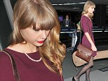 Flying solo: Unlucky in love Taylor Swift cuts a somewhat lonely figure as she departs Japan in beautiful burgundy dress