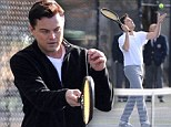 Game set match! Leonardo DiCaprio keeps his eye on the ball during an energetic game of tennis in a scene for his new film