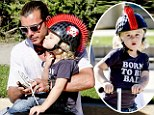 Born to be bad! Gwen Stefani's tough little guy Zuma dons Mohawk-style helmet and temporary tattoos to go scooting with his father and brother