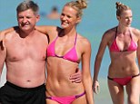 Supermodel Anne Vyalitsyna shores up another bikini as she hits Miami Beach with her father