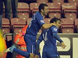 Jordi joy: Gomez (right) celebrates with James McArthur after completing his hat-trick