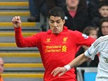 Tussle: Luis Suarez worked hard up front against Chico Flores