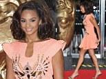 A dazzler of a dress: Alesha Dixon shines in fluorescent peach dress at the BAFTA Children's Awards