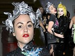 Jaime Winstone stood out from the crowd in an eccentric metallic headpiece at a party in London on Saturday