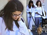 Downcast and out! Selena Gomez looked sad on a visit to the vet with her mother... as her relationship with Justin Bieber remains unclear