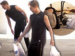 'Tis the season: Derek Hough touchingly brings food and water to homeless man