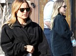 Mom-to-be Kristen Bell covers her growing baby bump on the set of House of Lies