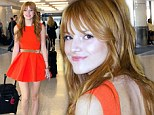 Tangerine dream: Bella Thorne's orange dress brings out her pretty red hair at LAX