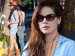 Keeping it brief: Michelle Monaghan shows off her trim pins in a ultra short shirt dress and boots