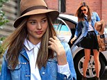 Having a Marilyn moment! Miranda Kerr avoids exposing more than she bargained for as she catches her miniskirt when it blows up in the wind