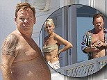 Time to lay off the red, red wine? UB40 star Ali Campbell shows off his belly while enjoying his favourite drink topless
