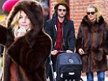 Taxi! Sienna Miller hails down a cab as she enjoys a Sunday stroll with baby Marlowe and fiancé Tom Sturridge