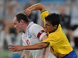 England striker Wayne Rooney in a tangle with Nilmar - England V Brazil in Doha Qatar