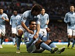 Banned: Tevez mimicked driving a car in Manchester City's victory over Villa