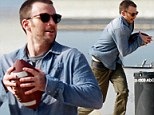 Captain American football! Chris Evans throws pigskin around on visit to the beach