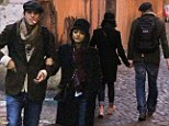 La dolce vita: Ashton Kutcher and Mila Kunis holds hands as they enjoy a romantic dawn stroll around Rome