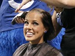 In it together: Colts mascot Blue shaved the heads of two Colts cheerleaders during the 4th quarter on Sunday