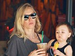 Keeping their energy levels up: Kimberly Stewart and her adorable mini-me Delilah make a quick coffee run