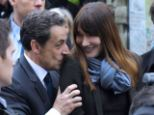 Conservative: Mrs Bruni-Sarkozy shares many of husband Nicolas Sarkozy's views, but she admits that they disagree when it comes to gay marriage. The pair are pictured together earlier this year