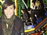 You're not scared, are you? Frankie Sandford enjoys a roller coaster ride at Winter Wonderland ... but boyfriend Wayne Bridge looks worried