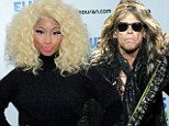 Nicki Minaj accuses Steven Tyler of making a 'racist comment' after he questions her ability to spot talent on American Idol