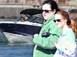 Rosie O'Donnell and wife have a whale of a time as they glimpse dolphins and manatees on romantic boat ride