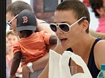 Charlize Theron shows baby Jackson her native country as she enjoys a lunch in Cape Town