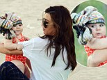 Just like mommy! Kourtney Kardashian wraps a printed scarf around her daughter Penelope's head in her favourite turban-style