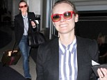 Diane Kruger hides make-up free look behind red shades as she sports androgynous blazer outfit