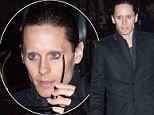 Raising... no eyebrows! Jared Leto shows off his missing facial hair on the red-carpet after being waxed for new movie
