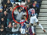 Gesture: The fan can be clearly seen making what appears to be a monkey gesture at West Brom's Romelu Lukaku as he celebrates scoring his side's third goal on Saturday