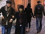 La dolce vita: Ashton Kutcher and Mila Kunis holds hands as they enjoy a romantic dawn stroll around Rome