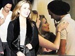 A match made in musical heaven: Caggie Dunlop kisses new beau Lawson singer Andy Brown outside nightclub
