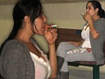Stressed Octomom puffs on a cigarette outside her home after rehab treatment for Xanax dependency