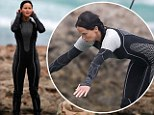Just jump! Jennifer Lawrence takes the plunge and shows off her curves in a clingy wetsuit to film water scenes for The Hunger Games: Catching Fire