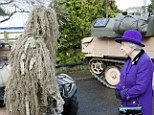 Perplexed: Queen Elizabeth as she meets a sniper from the Household Cavalry at Combermere Barracks in Windsor today