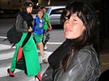 Not a 'plane' outfit: Boardwalk Empire star Paz de la Huerta stalks through airport in bright green split dress and red stockings