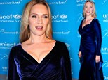 Uma Thurman shows off her trim post-pregnancy figure in midnight blue velvet dress... four months after giving birth